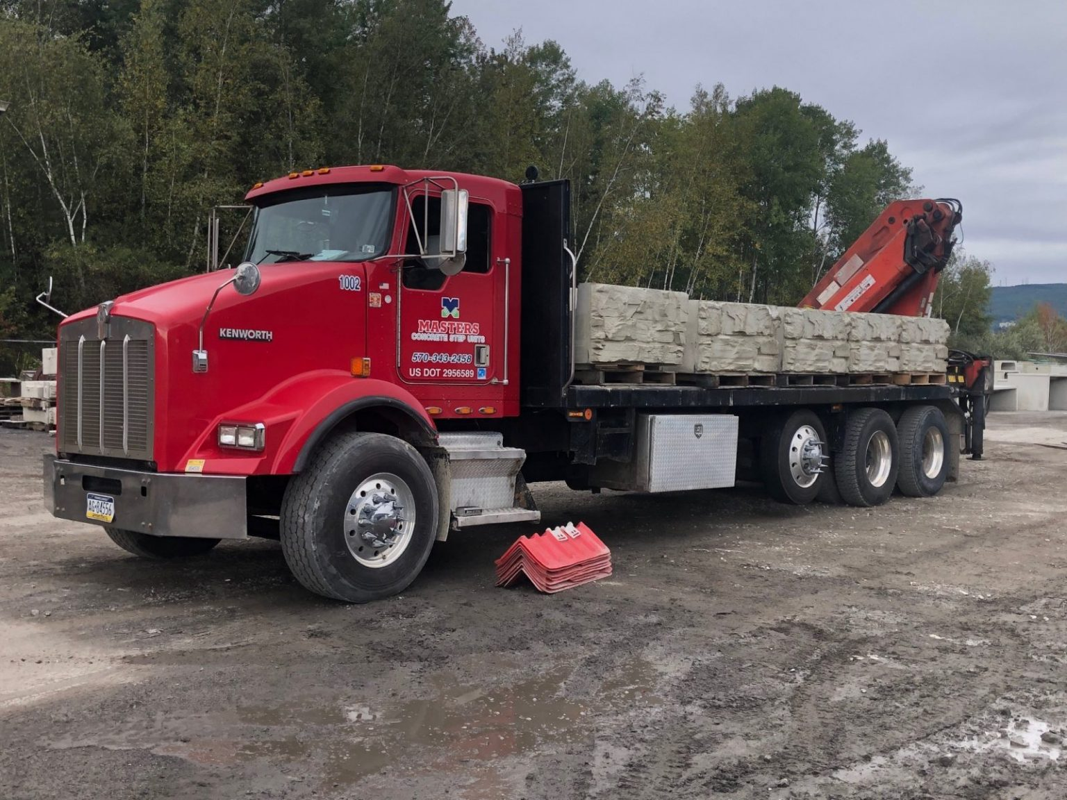 MaxumStone block units being shipped on a flatbed delivery truck