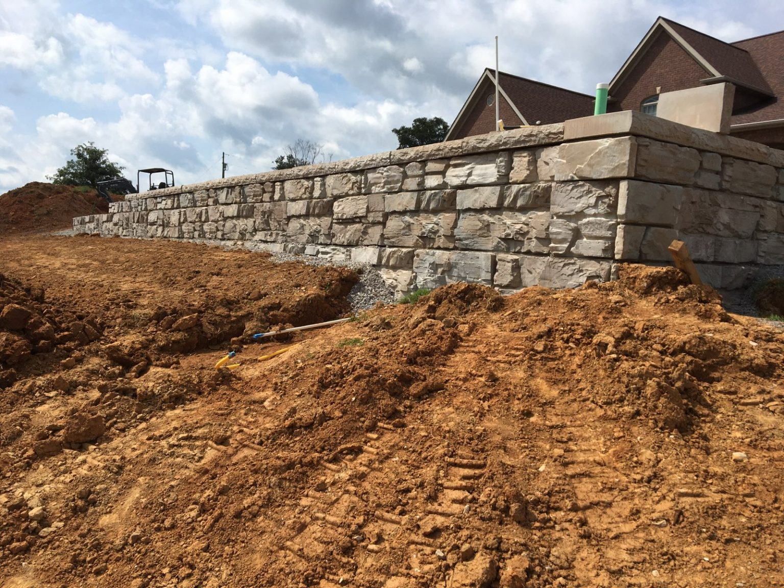 Installation of a Residential MaxumStone Ledge Face Retaining Wall In Kentucky